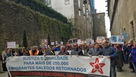 Los emigrantes retornados por las calles de Santiago el pasado 21 de marzo.