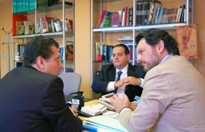 Miranda, en la reunión con Coelho (a la izquierda) y Péres (en medio al fondo).