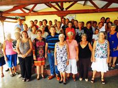 Un grupo de participantes en la celebración del Día del Conde Santo en La Habana. Al centro la presidenta de 'Hijos de Lorenzana' Josefina Rodríguez.