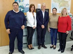 Los directivos de FAER con el secretario de Acción Exterior de la Junta de Andalucía, Ángel Luis Sánchez Muñoz (centro).