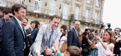 Mariano Rajoy junto a Feijóo en Santiago.