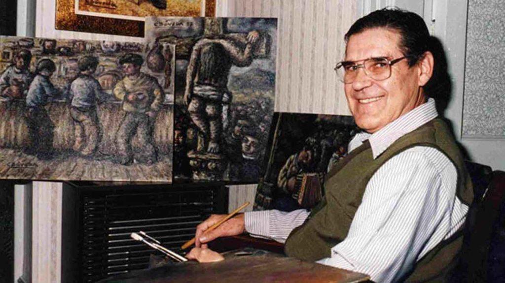 Carlos Bóveda, ante una de sus pinturas.