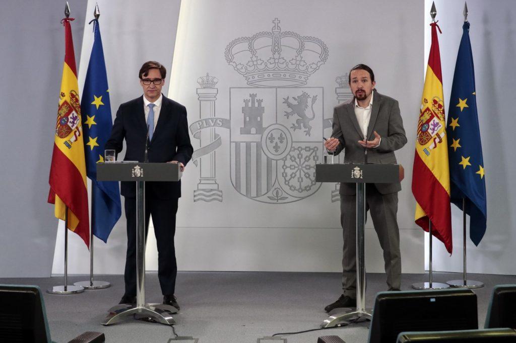 Salvador Illa y Pablo Iglesias durante su comparecencia telemática para informar de las salidas a la calle de los niños.