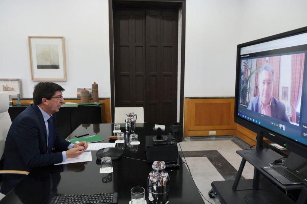 Juan Marín y el alcalde de Sevilla durante su videoconferencia.